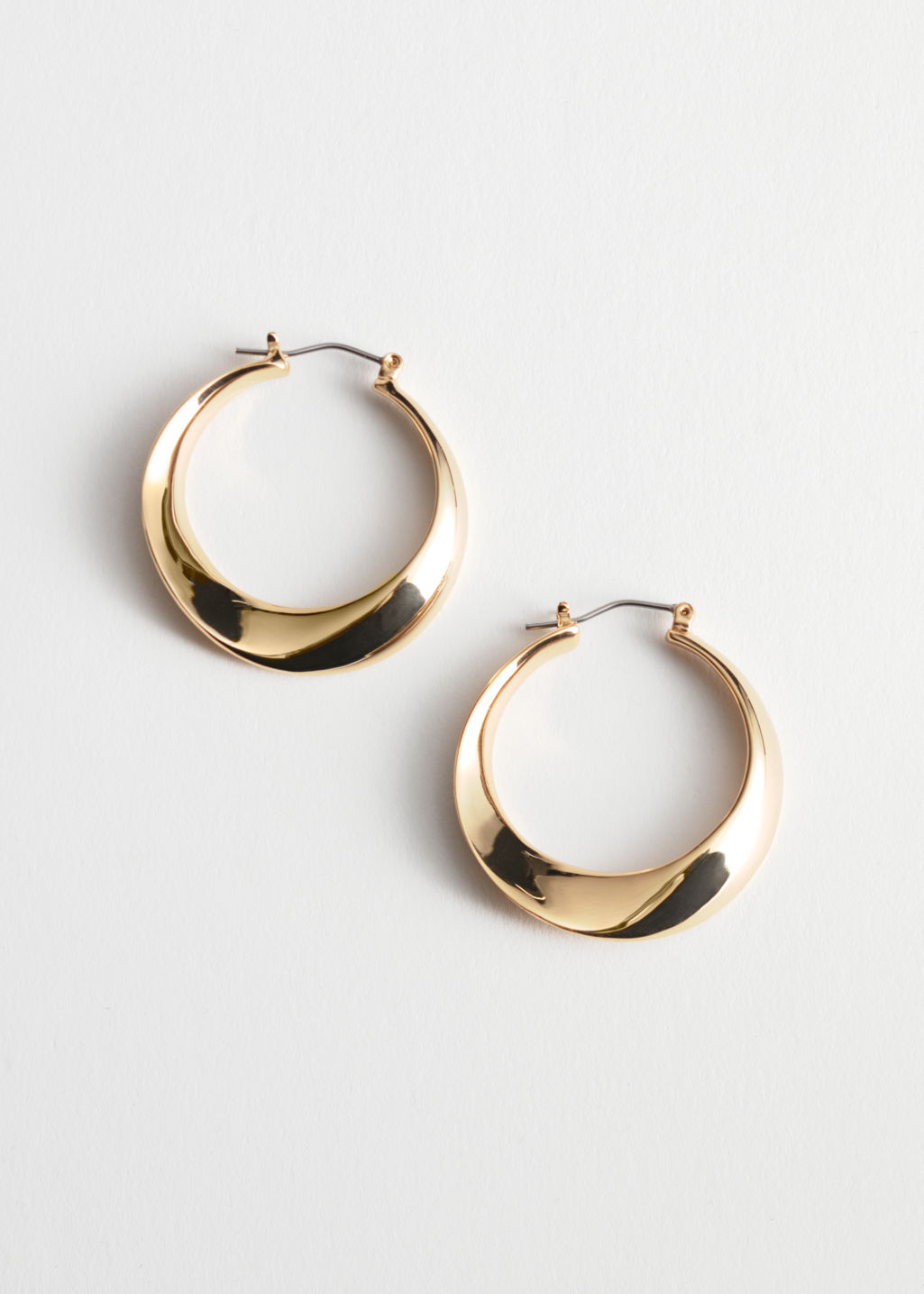 StillLife Front Image of Stories Twisted Hoop Earrings in Gold