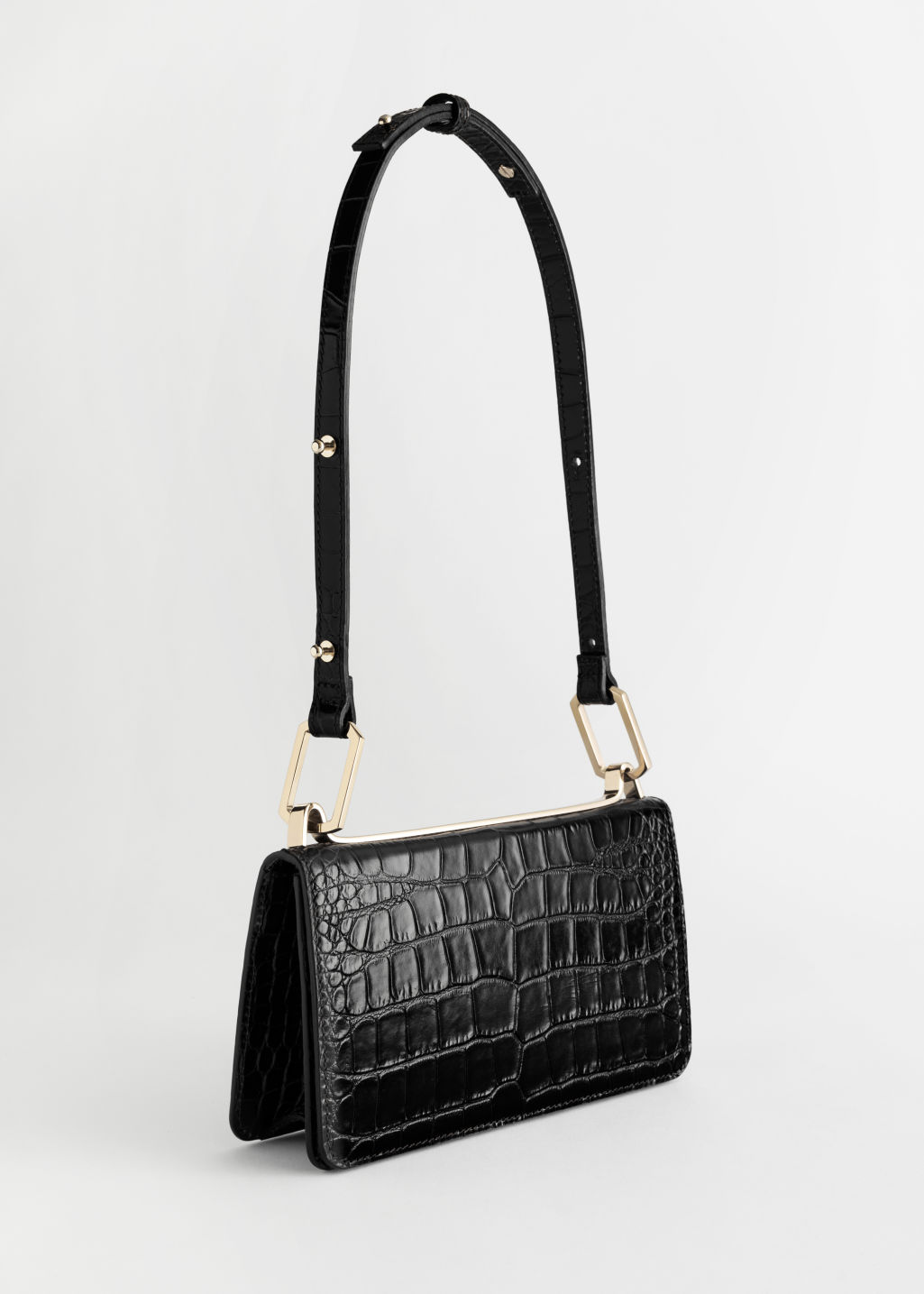 Front image of Stories duo buckle croc baguette in black