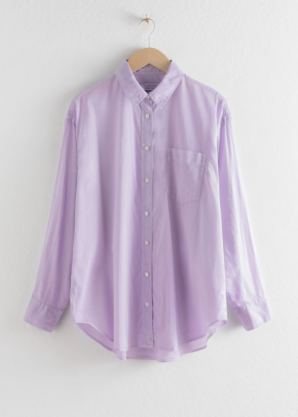 Front image of Stories oversized organic cotton button up shirt in purple