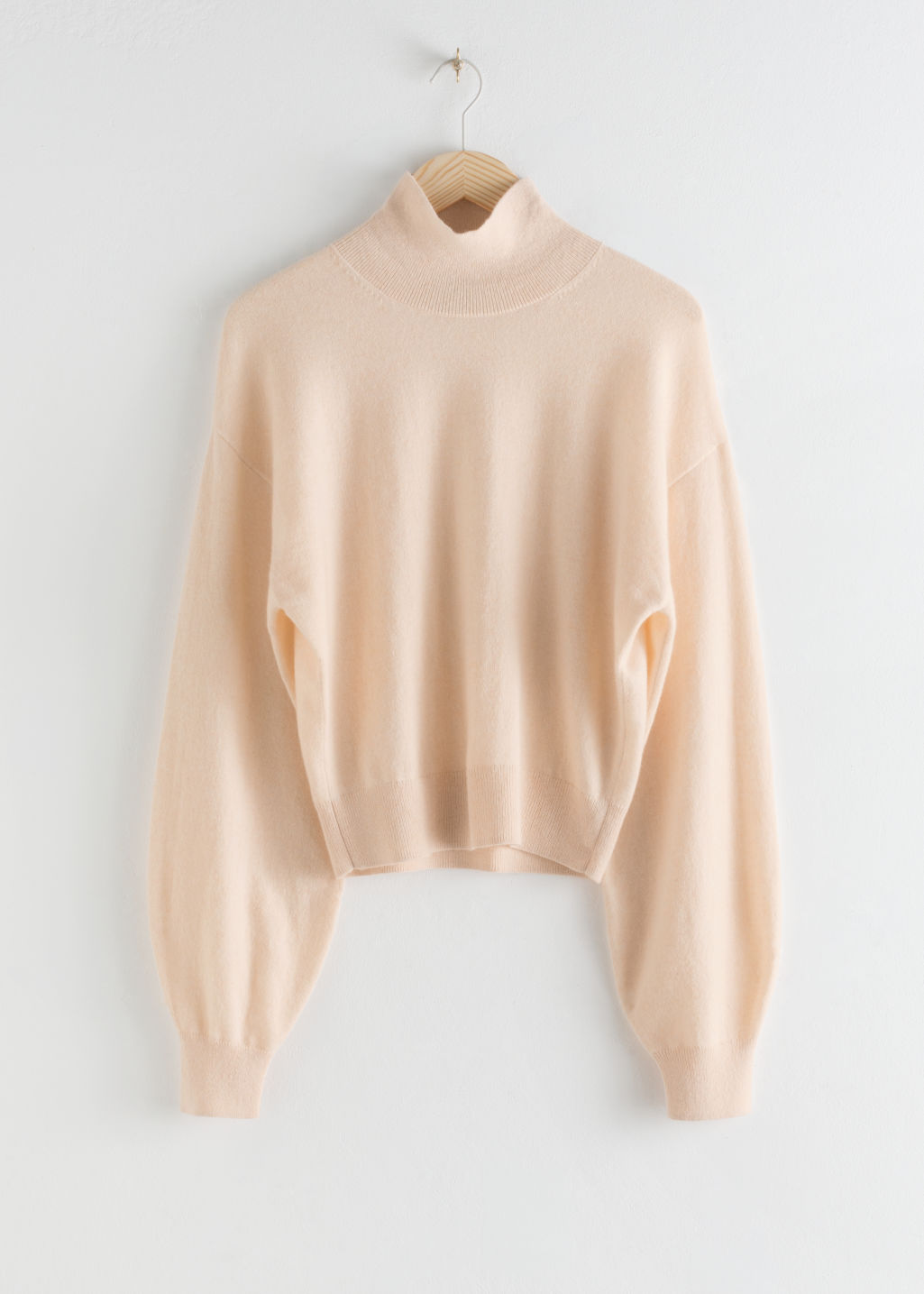 StillLife Front Image of Stories Cashmere Puff Sleeve Turtleneck in Orange