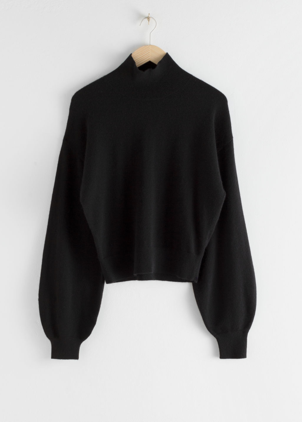 Front image of Stories cashmere puff sleeve turtleneck in black