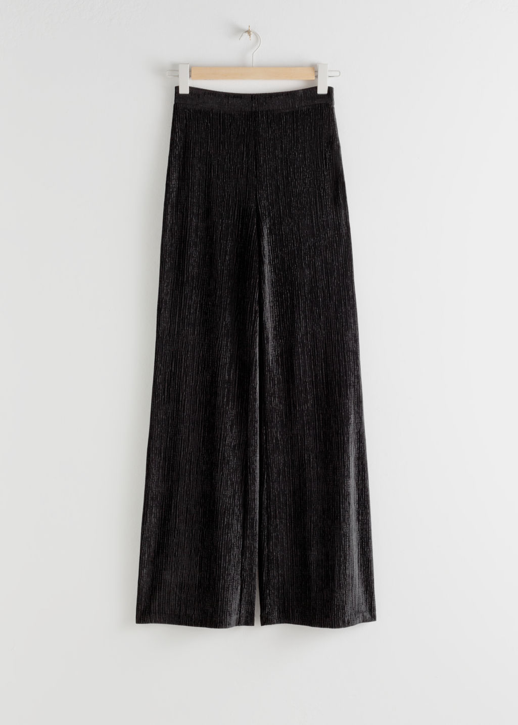 Front image of Stories flowy velour ribbed trousers in black