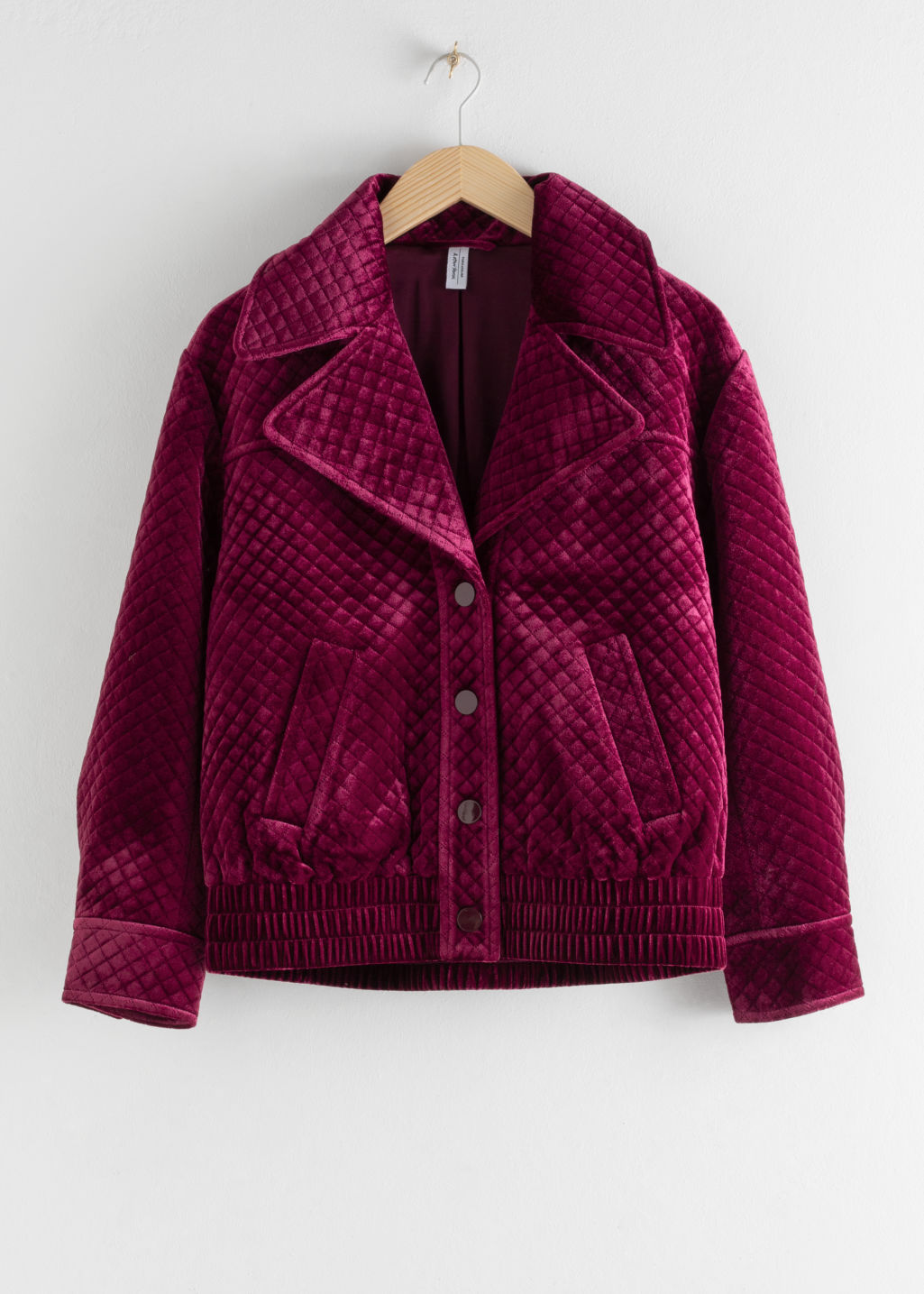 Front image of Stories quilted velour jacket in pink
