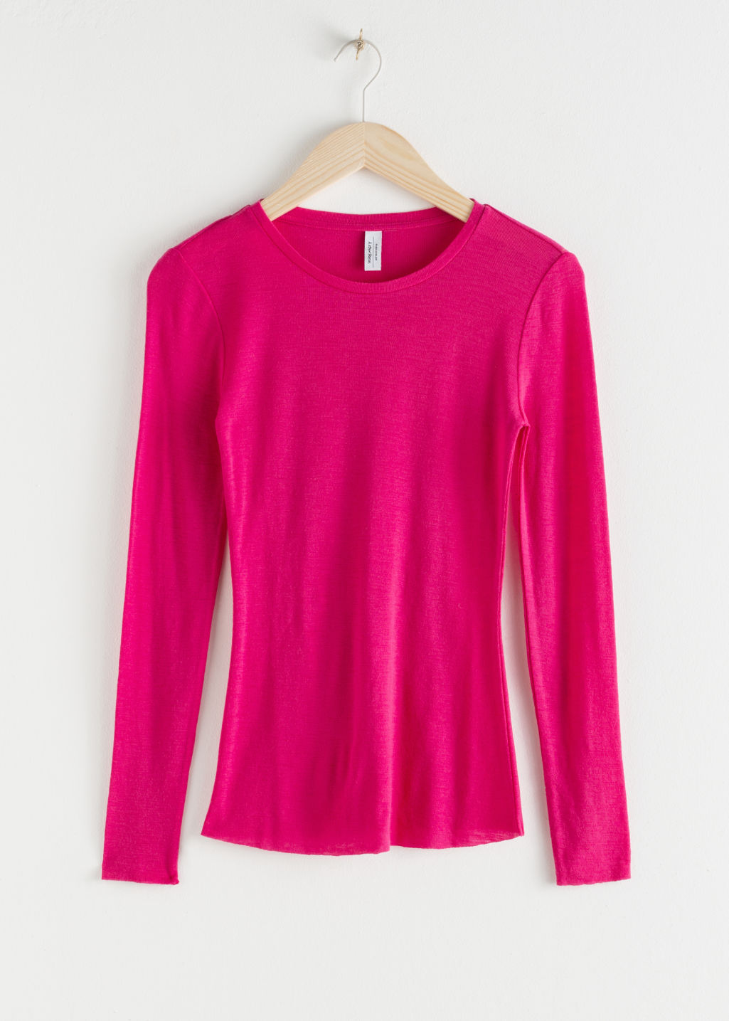 Front image of Stories fitted wool knit top in pink