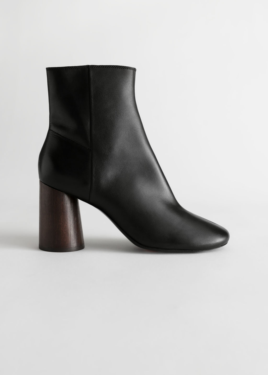 StillLife Front Image of Stories Almond Toe Leather Ankle Boots in Black