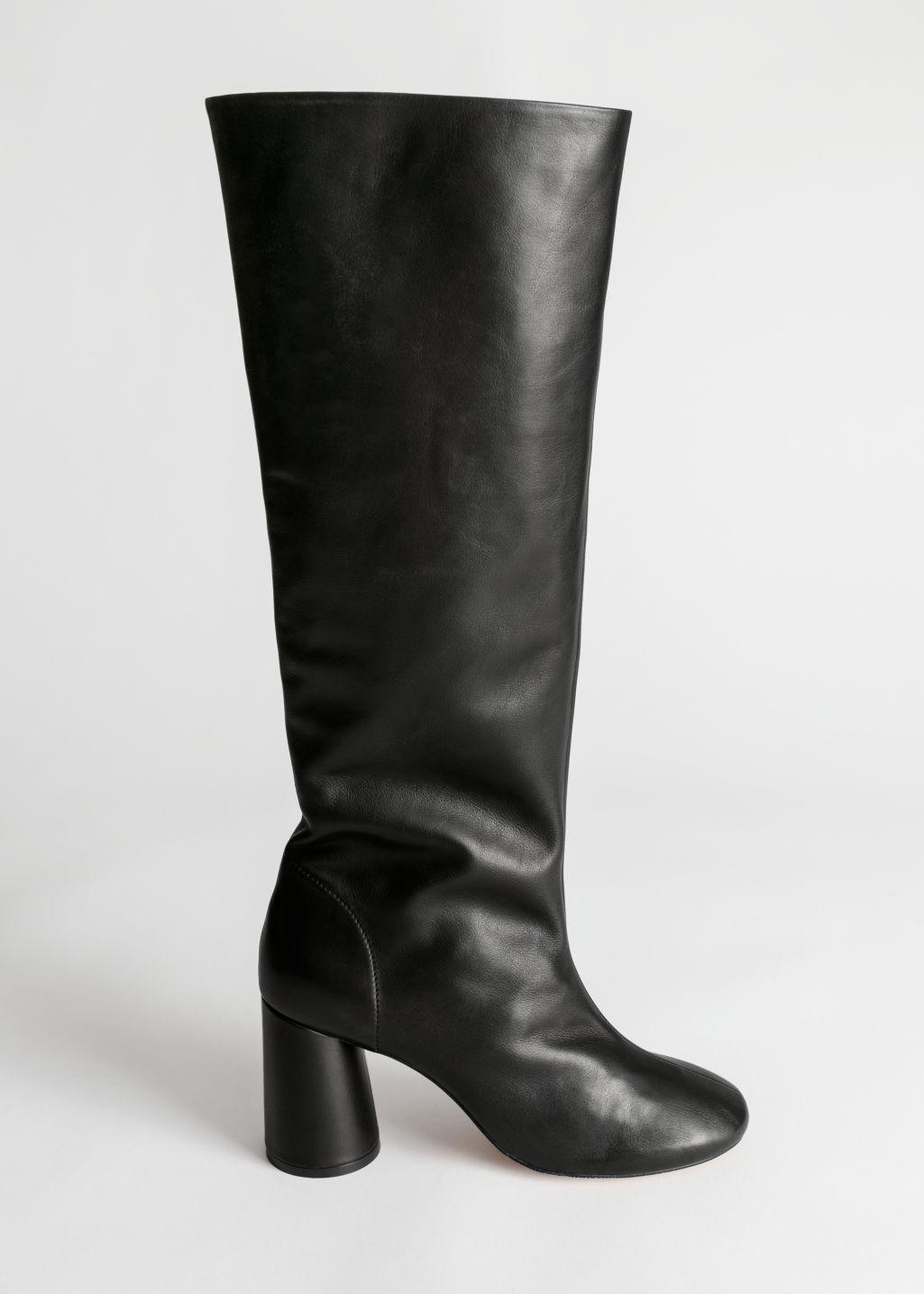 Front image of Stories gathered slouch leather boots in black