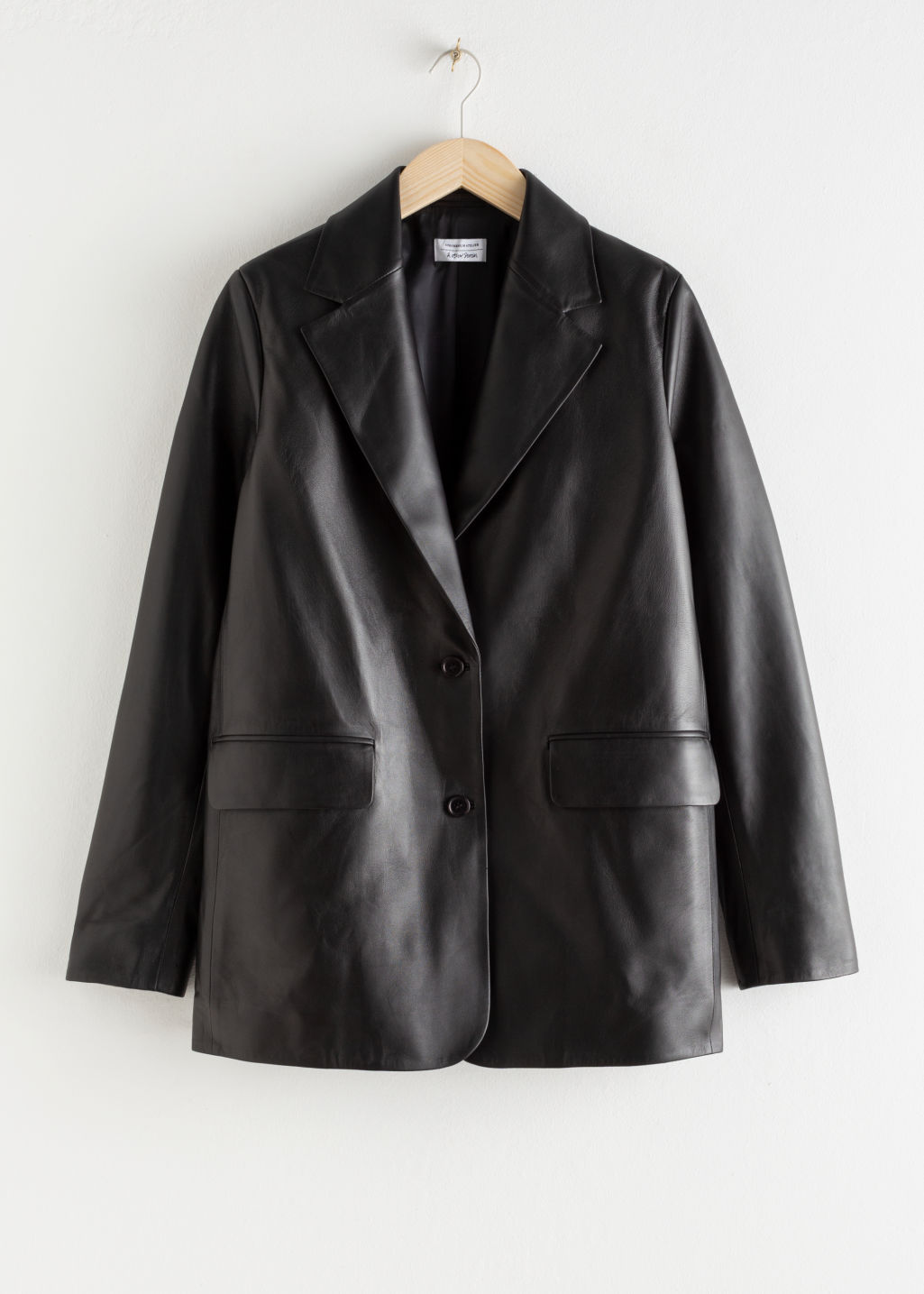 Front image of Stories oversized leather blazer in black