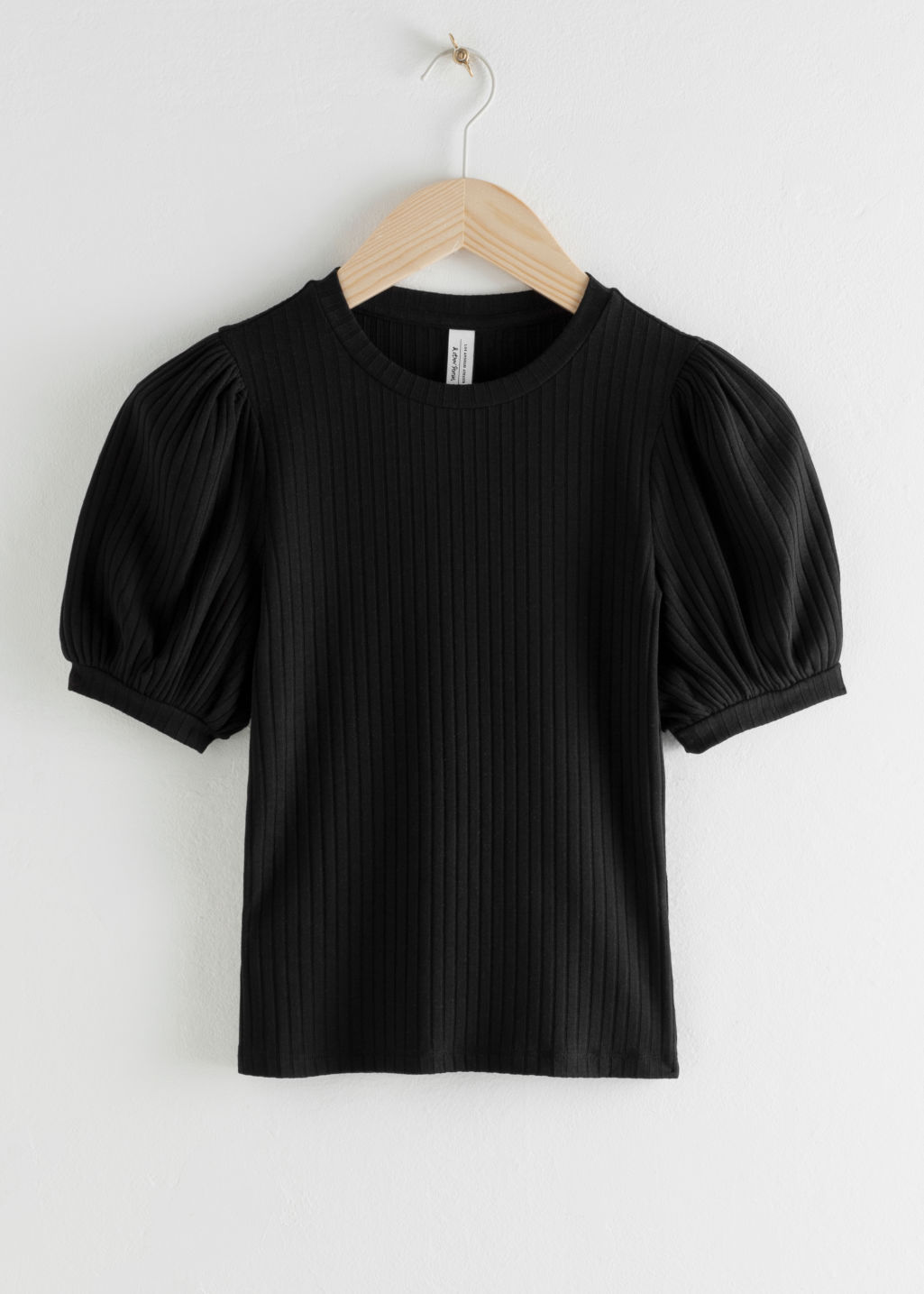 Front image of Stories high neck puff sleeve top in black