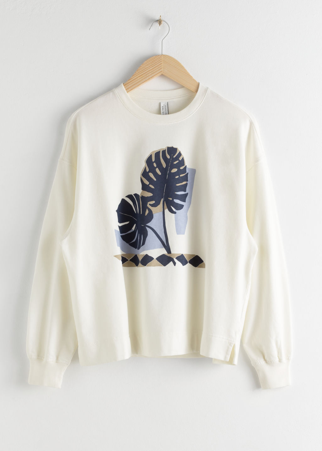 Front image of Stories cotton graphic print sweater in white