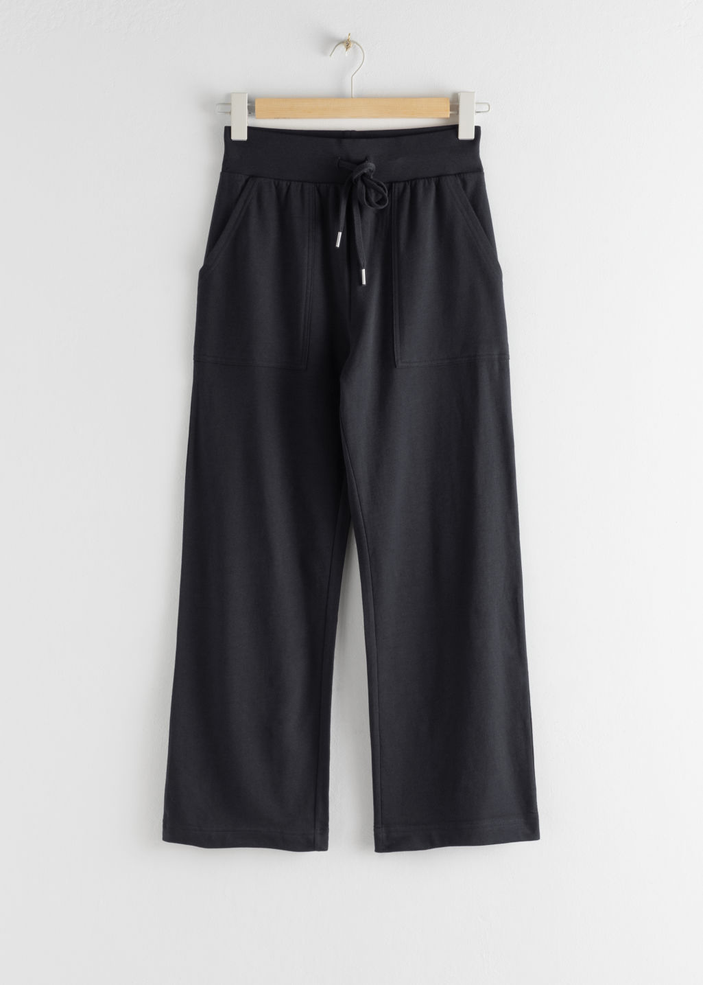 Front image of Stories organic cotton jogger trousers in blue