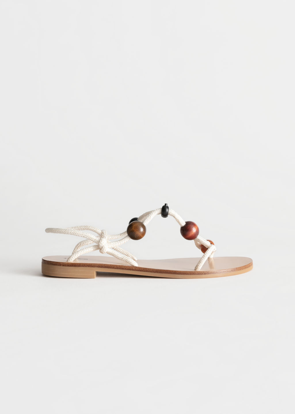 Front image of Stories beaded rope sandals in white