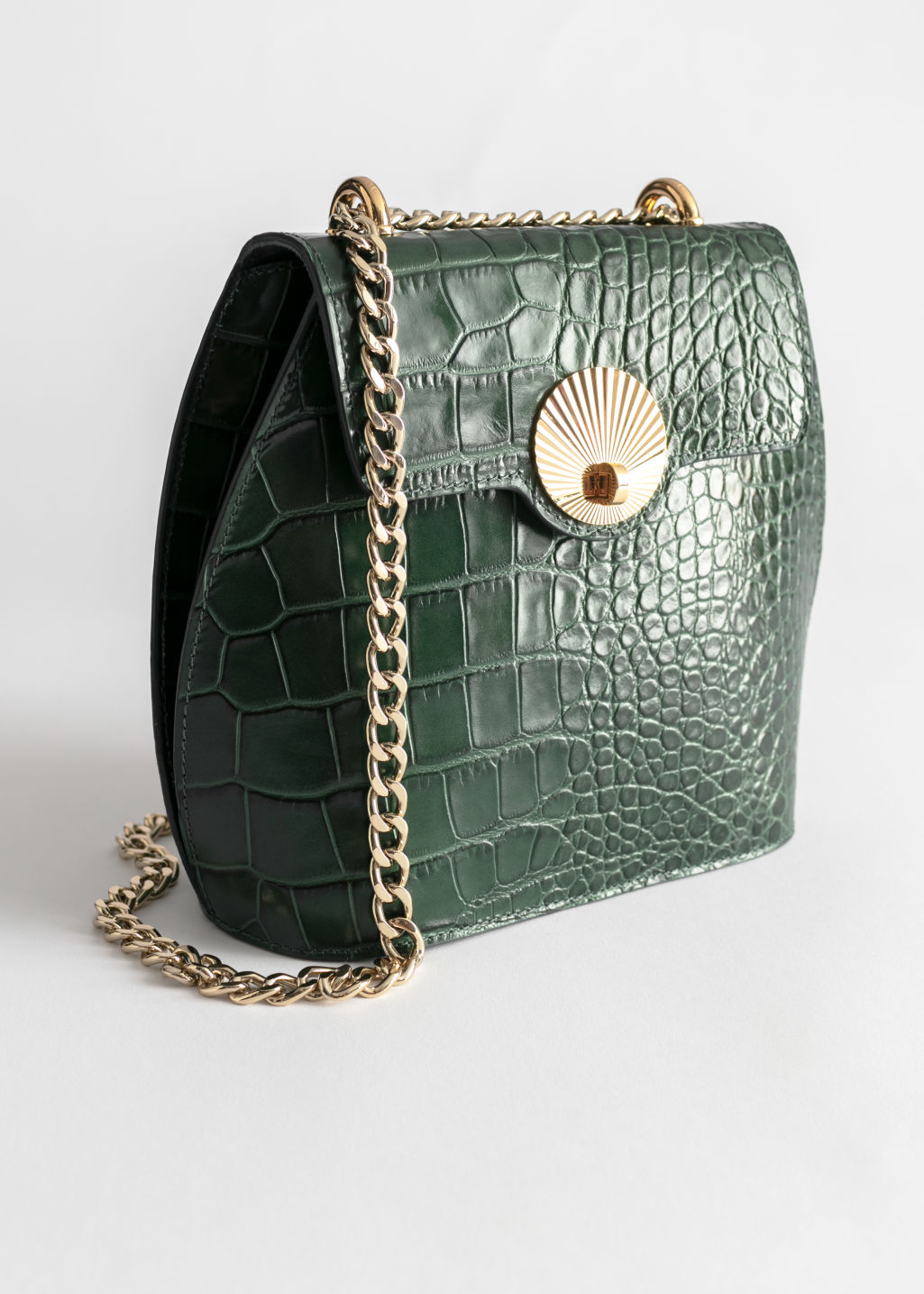 Front image of Stories curved croc leather small bag in green