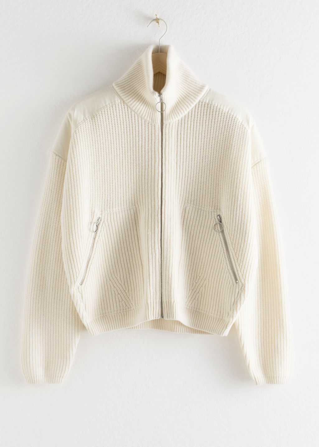 Front image of Stories wool blend zip turtleneck cardigan in white