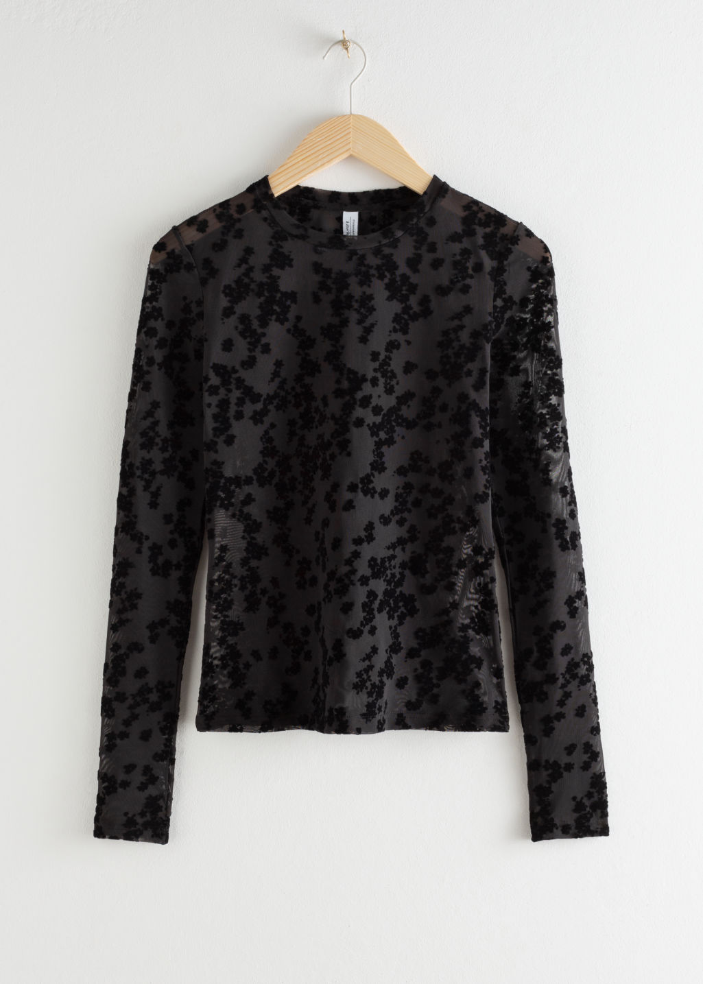 Front image of Stories fitted floral jacquard top in black