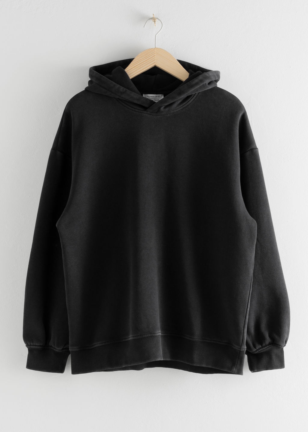 StillLife Front Image of Stories Oversized Hooded Sweatshirt in Black