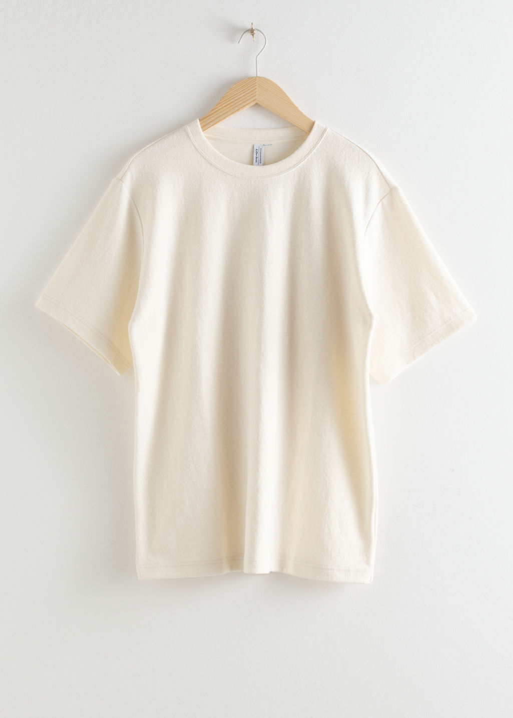 Front image of Stories oversized washed cotton t-shirt in white