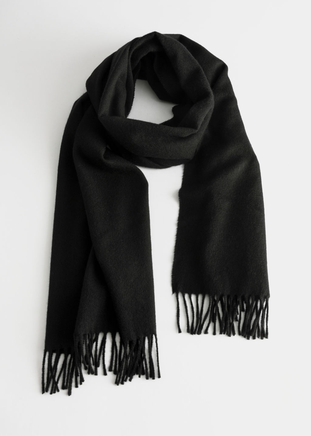 Front image of Stories cashmere fringe trim scarf in black