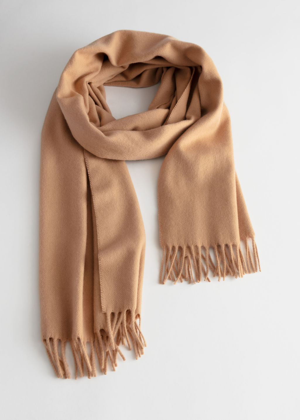 Front image of Stories cashmere fringe trim scarf in beige