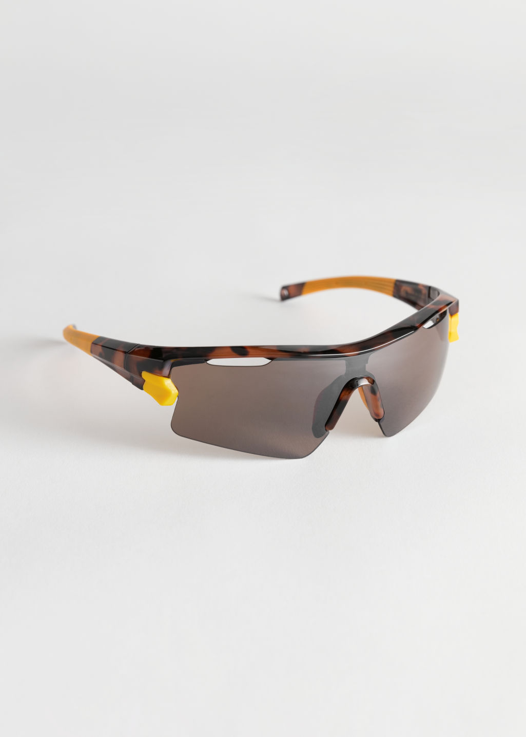 Front image of Stories sporty tortoise sunglasses in beige