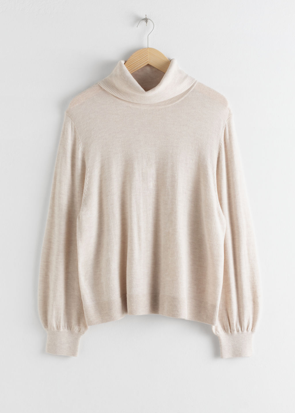 Front image of Stories soft wool blend turtleneck sweater in white
