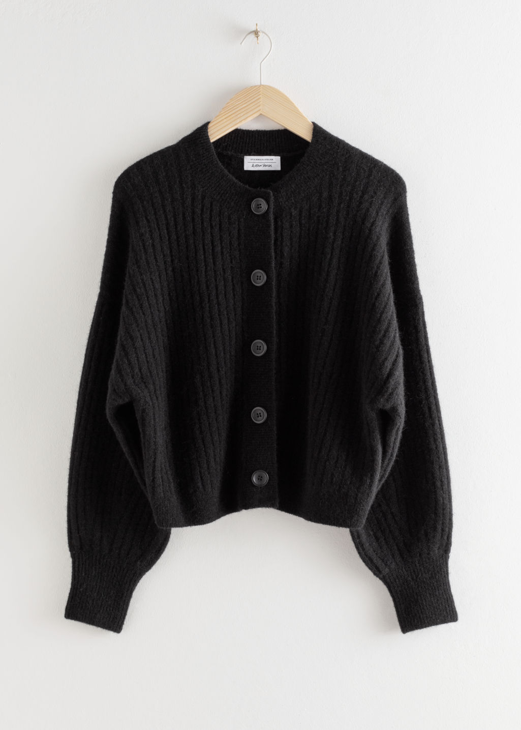 Front image of Stories oversized ribbed crewneck cardigan in black