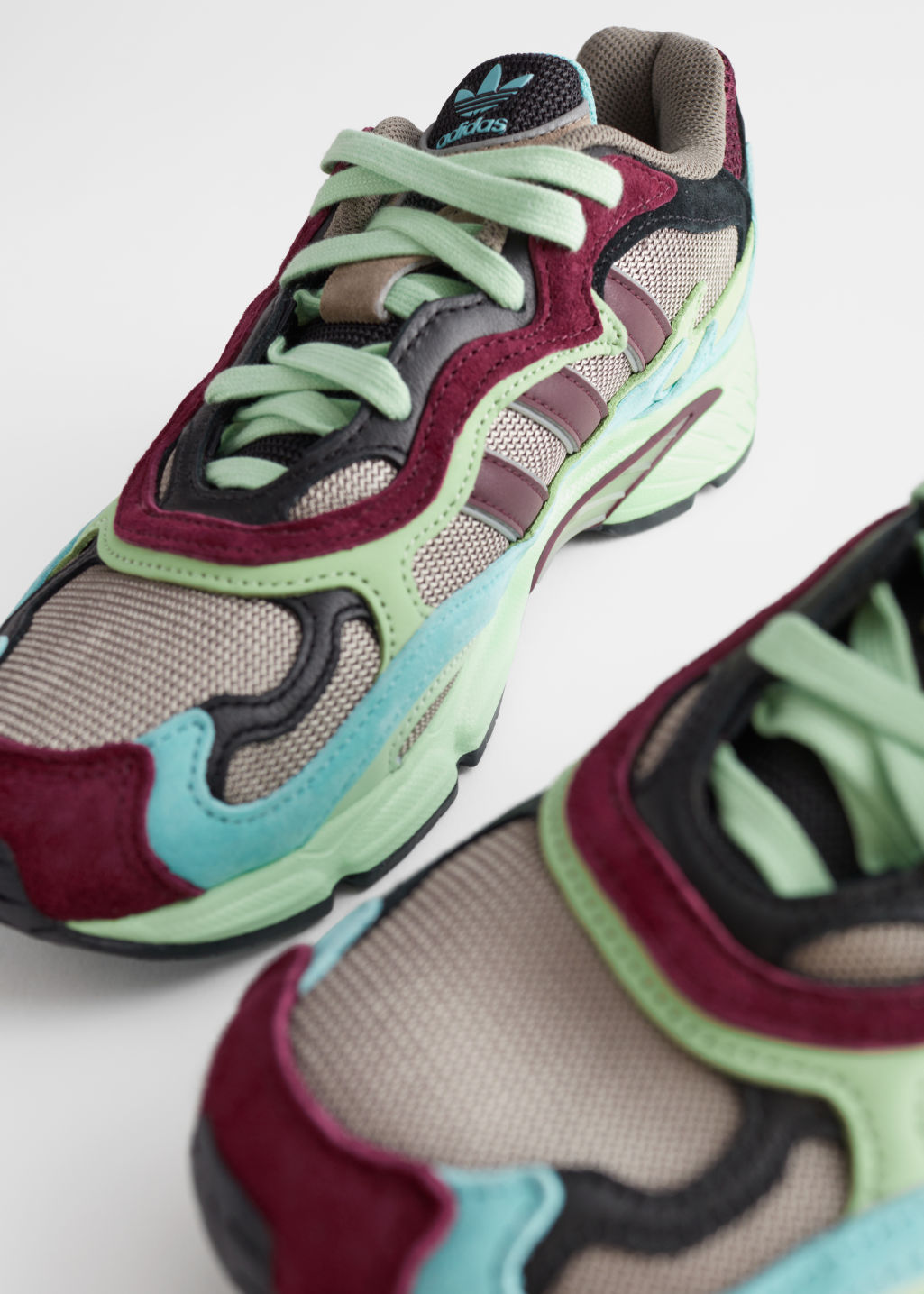 Front image of Stories adidas temper run in pink