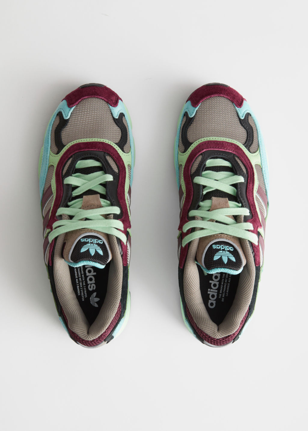 Side image of Stories adidas temper run in pink