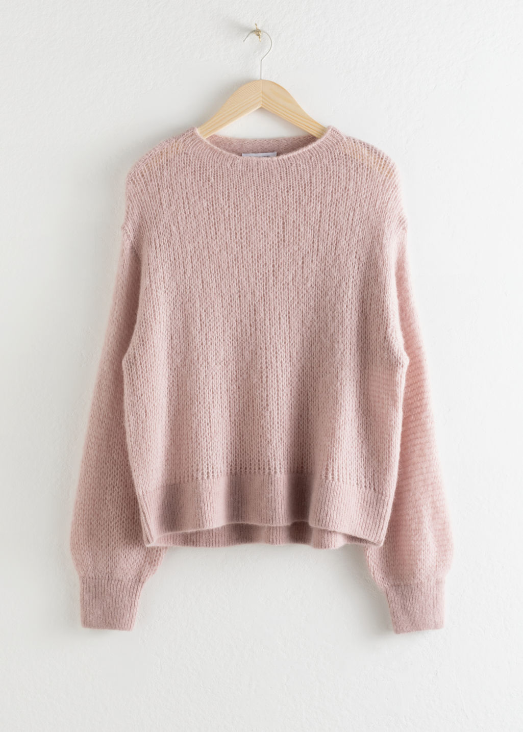 Front image of Stories relaxed wool blend knit sweater in pink