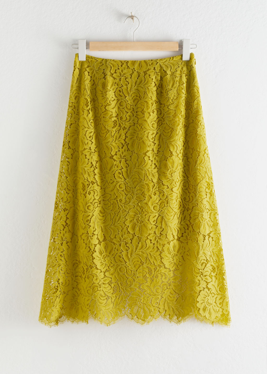Front image of Stories floral lace midi skirt in yellow
