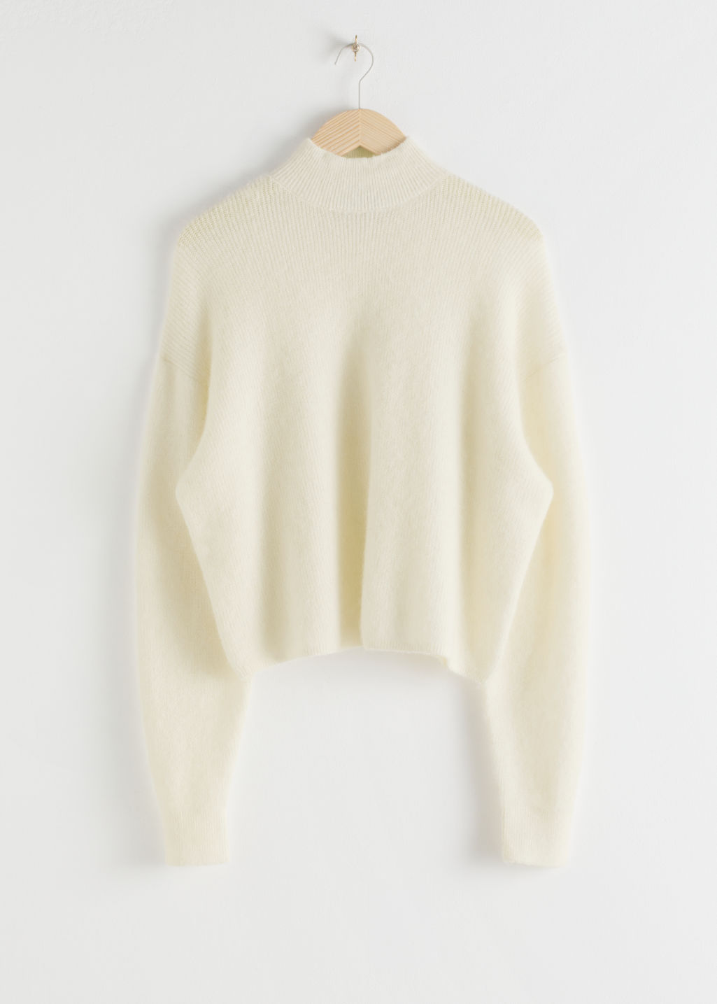 StillLife Front Image of Stories Wool Blend Oversized Mock Neck Sweater in White
