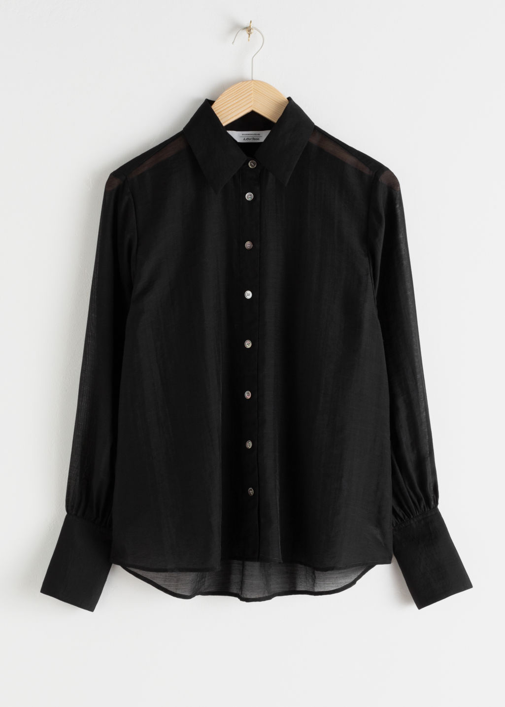 StillLife Front Image of Stories Semi-Sheer Lyocell Blend Blouse in Black