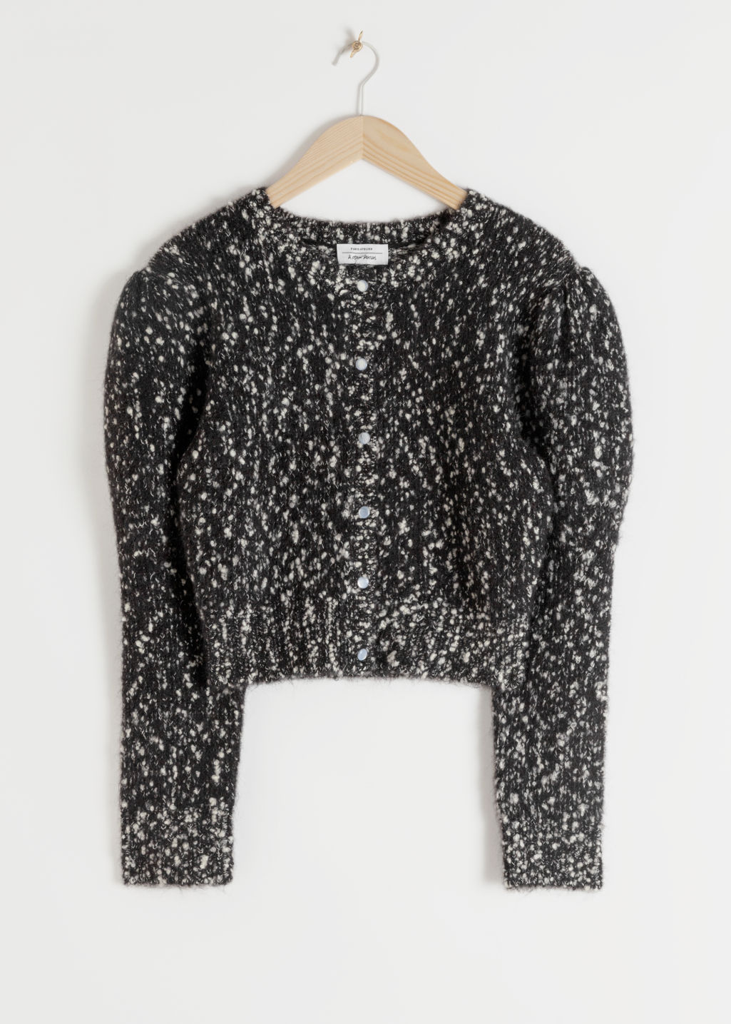 StillLife Front Image of Stories Puff Sleeve Bouclé Cropped Cardigan in Black