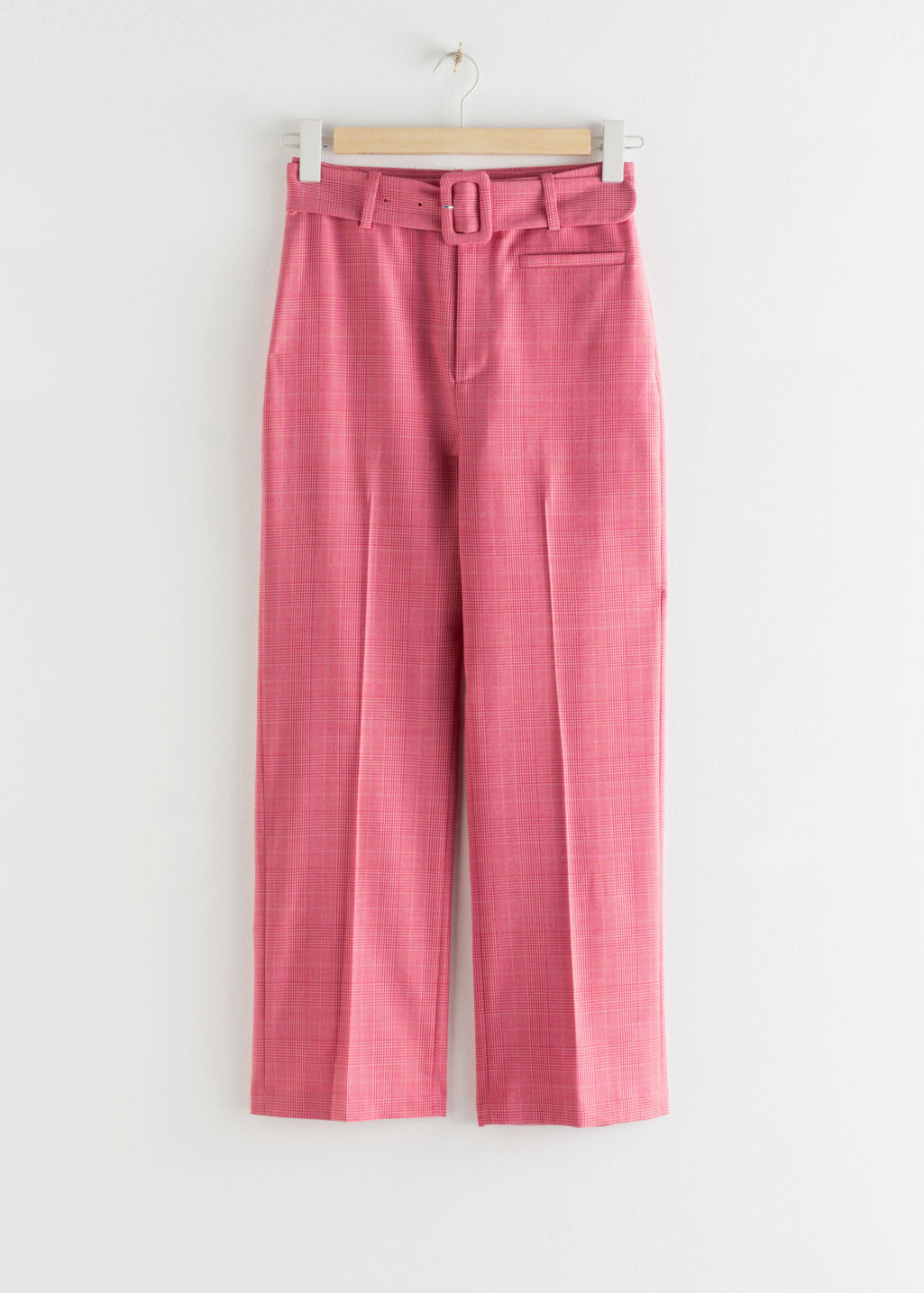 Front image of Stories belted plaid kick flare trousers in pink