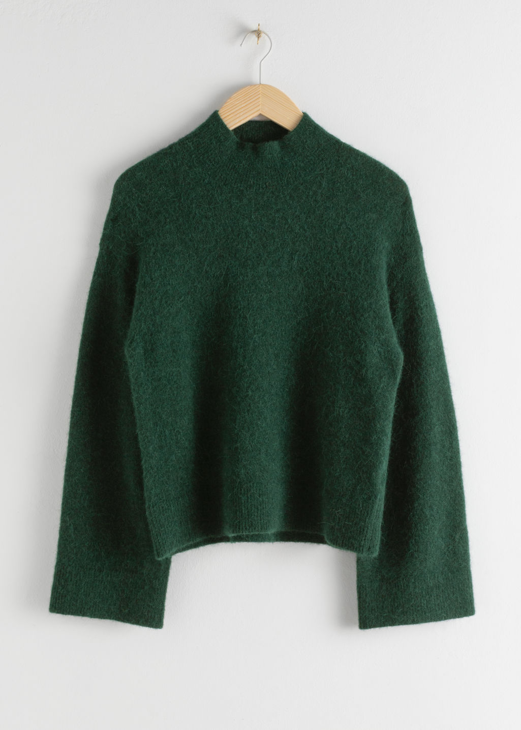 Front image of Stories alpaca blend turtleneck sweater in green
