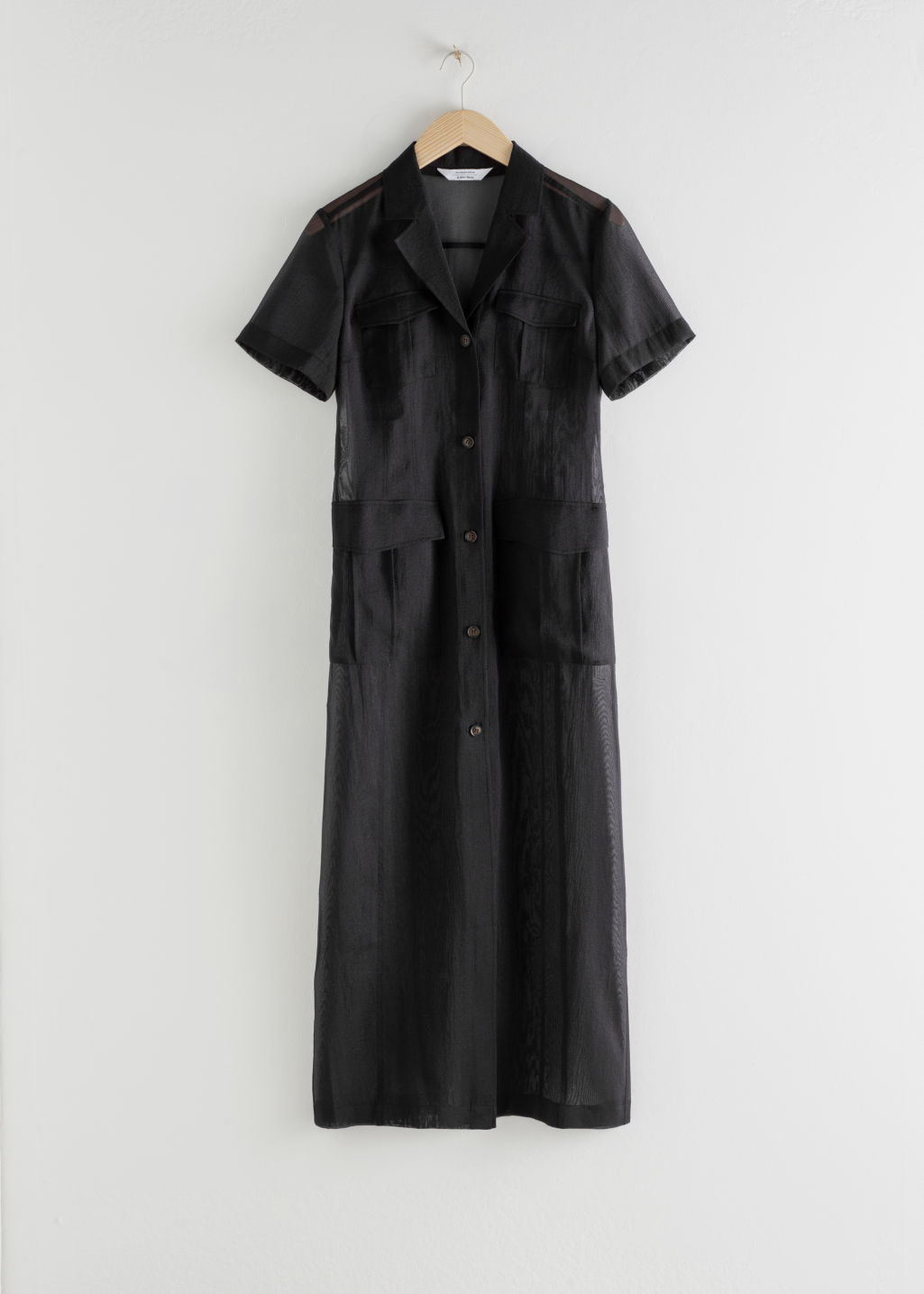 StillLife Front Image of Stories Sheer Patch Pocket Maxi Dress in Black
