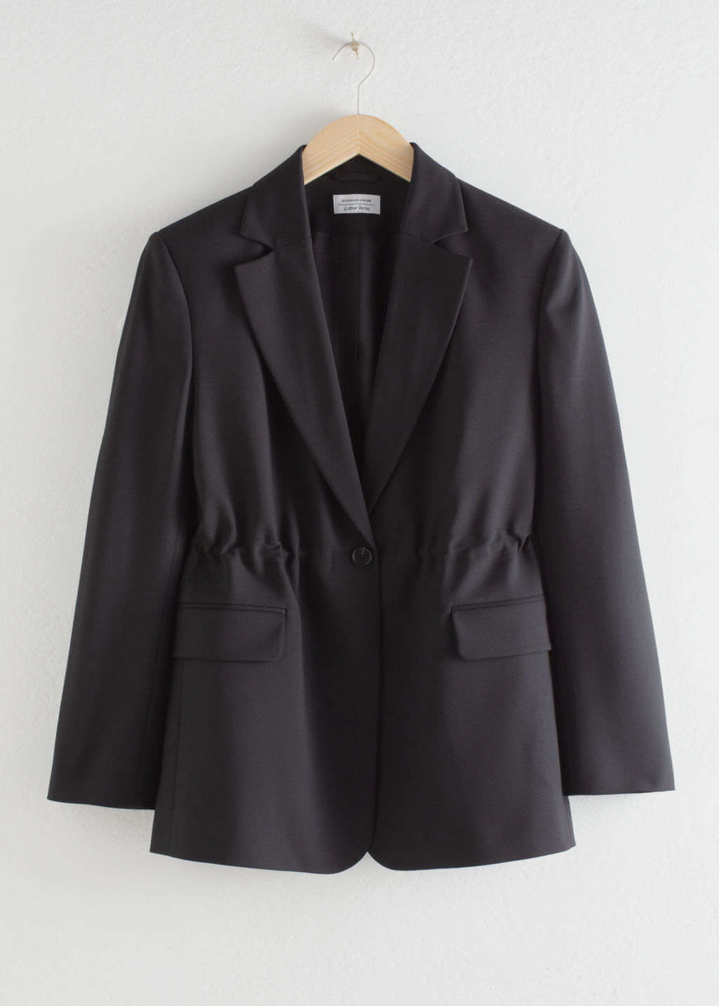 Front image of Stories gathered square shoulder blazer  in black