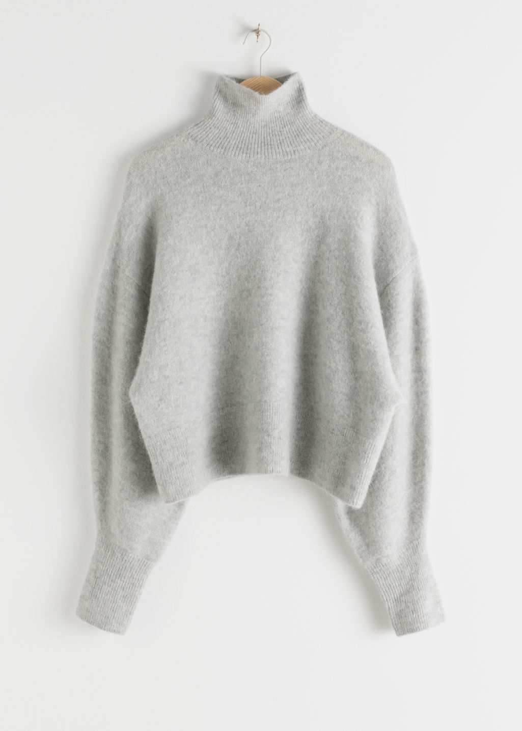 StillLife Front Image of Stories Soft Wool Blend Turtleneck Sweater in Grey