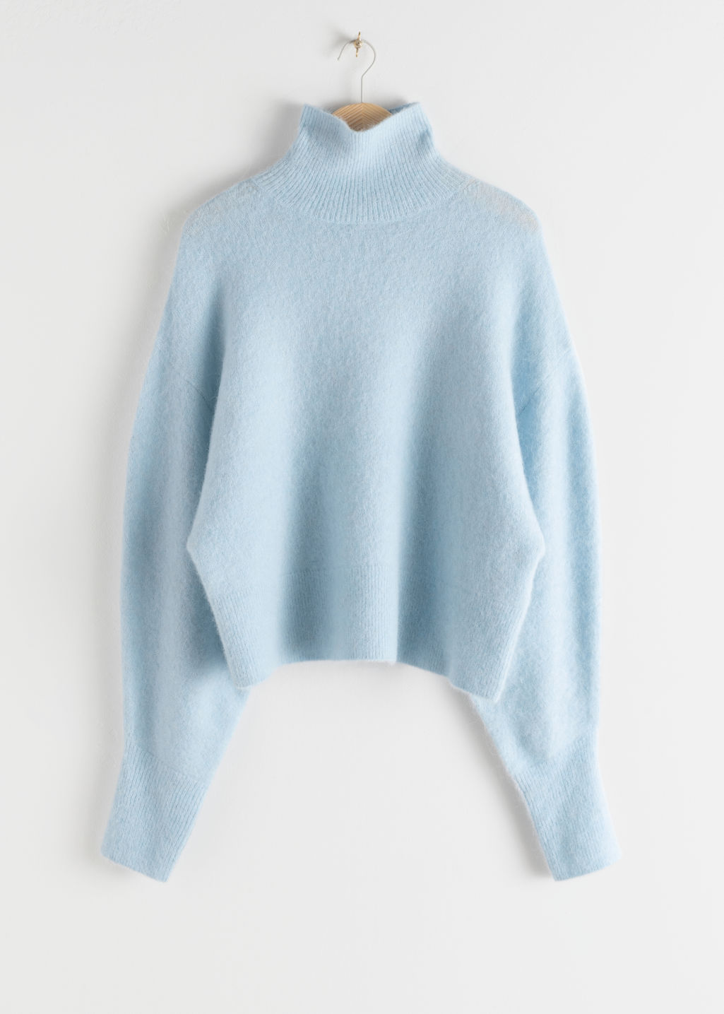 Front image of Stories soft wool blend turtleneck sweater in blue