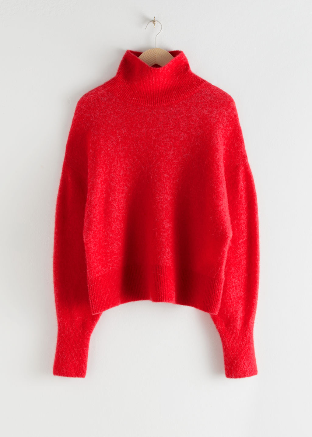 StillLife Front Image of Stories Soft Wool Blend Turtleneck Sweater in Red