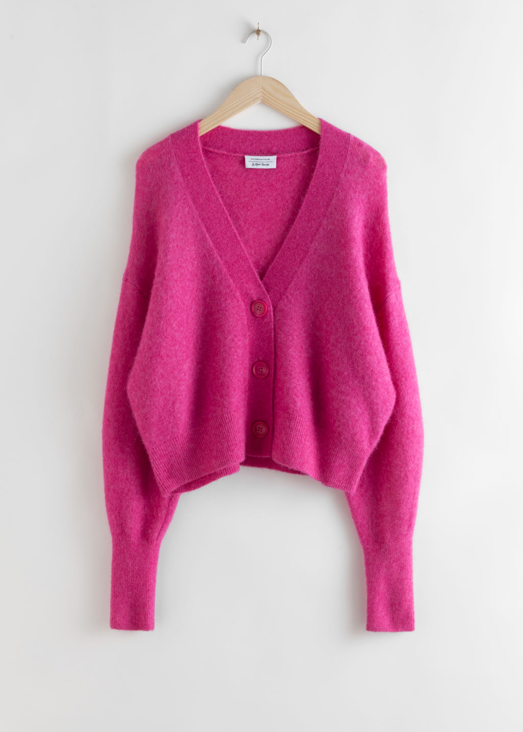 Front image of Stories alpaca blend puff sleeve cardigan in pink