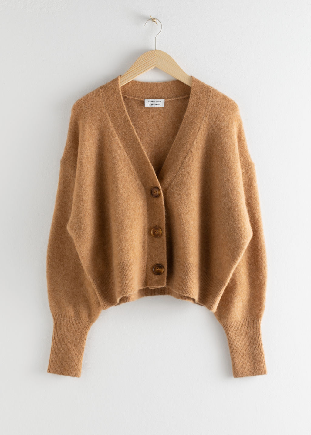 Front image of Stories alpaca blend puff sleeve cardigan in beige