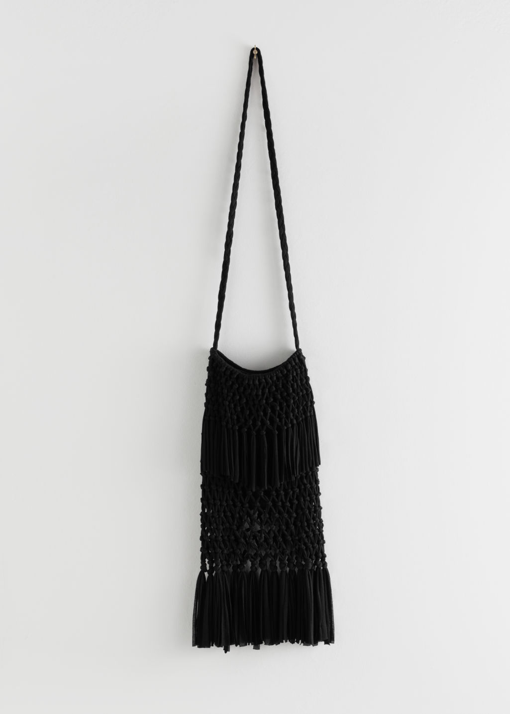 Front image of Stories cotton macrame fringe bag  in black