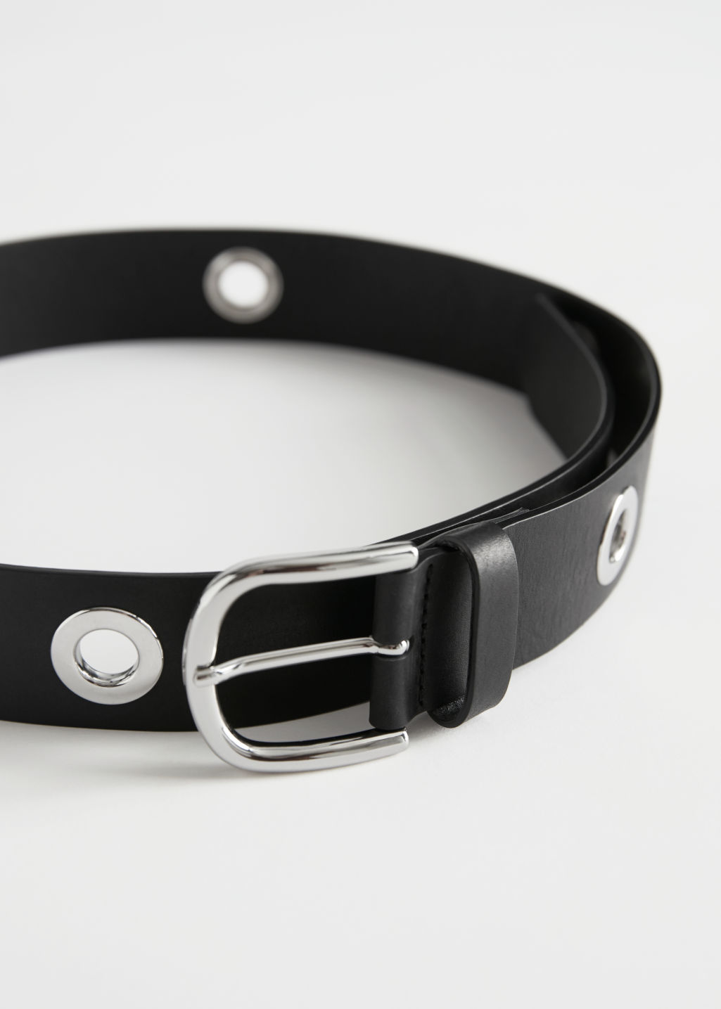 Front image of Stories eyelet studded leather belt in black