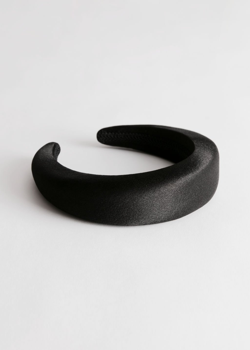 Front image of Stories satin hairband in black