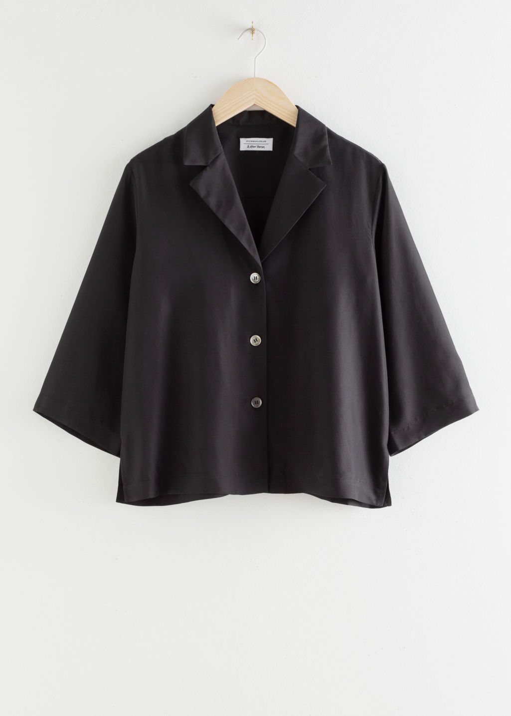 Front image of Stories silk open collar boxy shirt in black