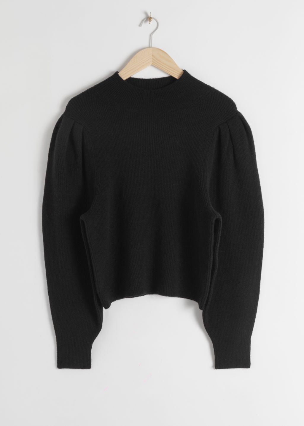 Front image of Stories mock neck puff sleeve sweater in black