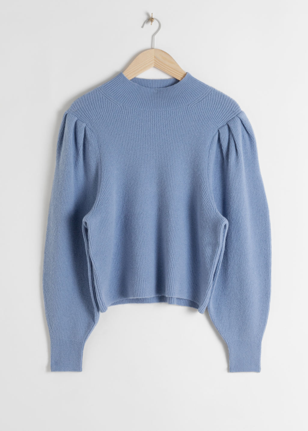 Front image of Stories mock neck puff sleeve sweater in blue
