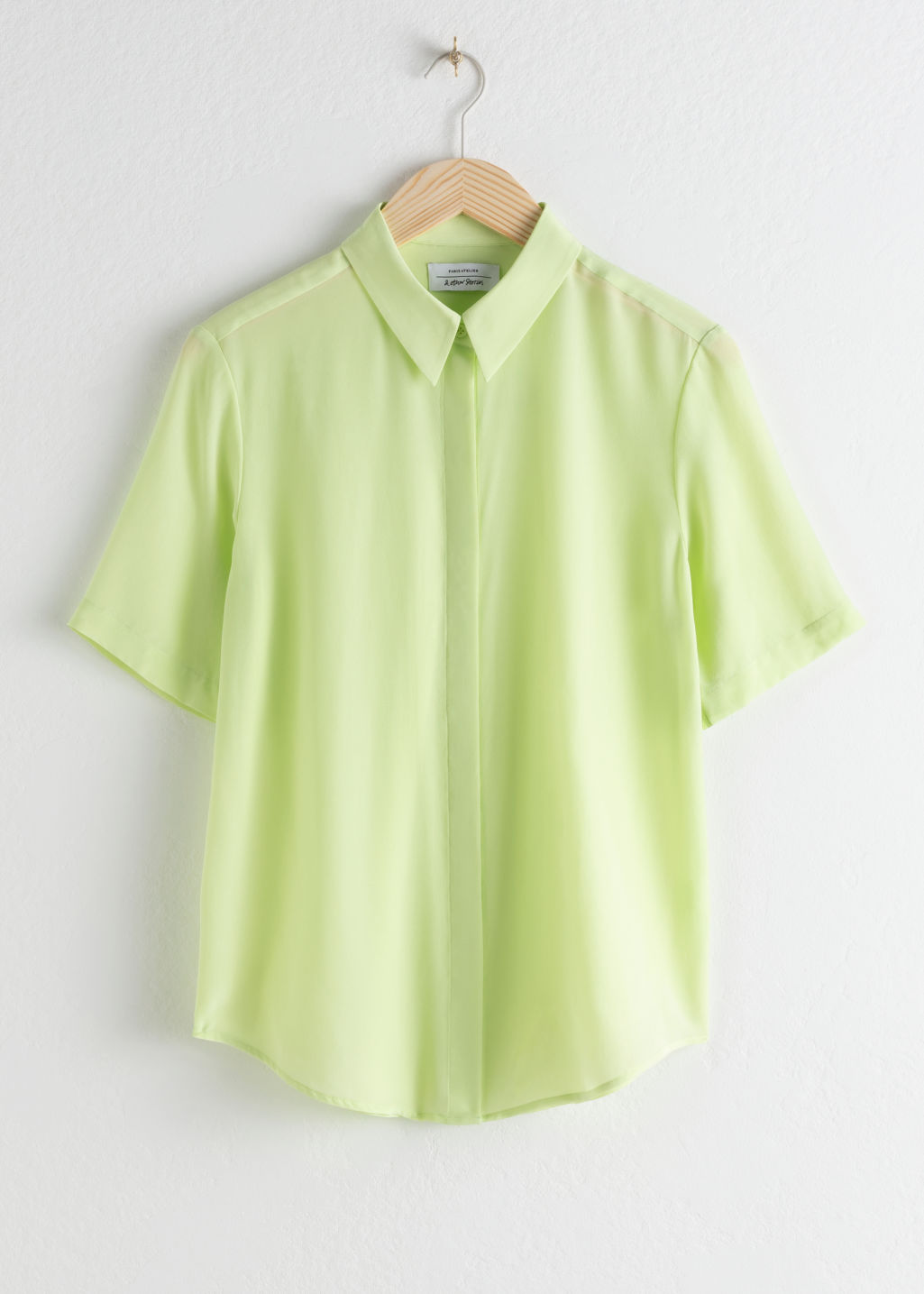 Front image of Stories short sleeve silk button up in yellow