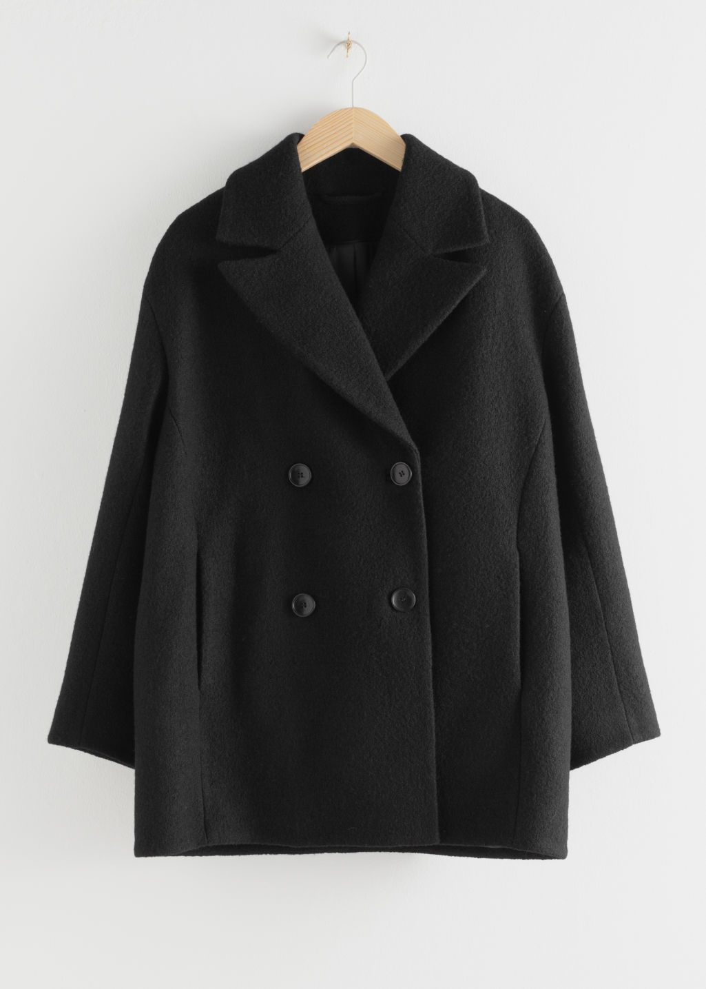 Front image of Stories double breasted bouclé coat in black
