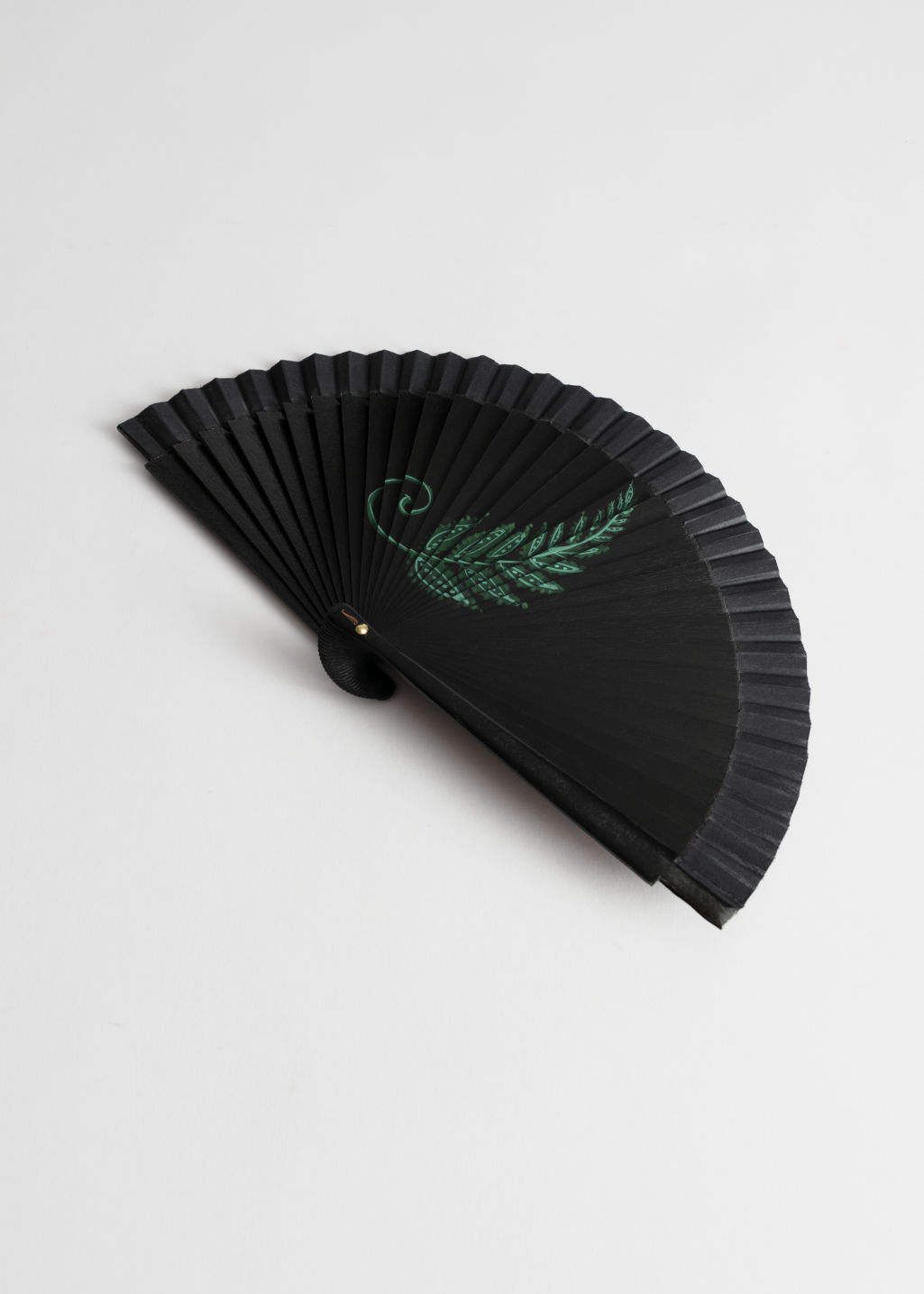 Front image of Stories wooden fern fan in black
